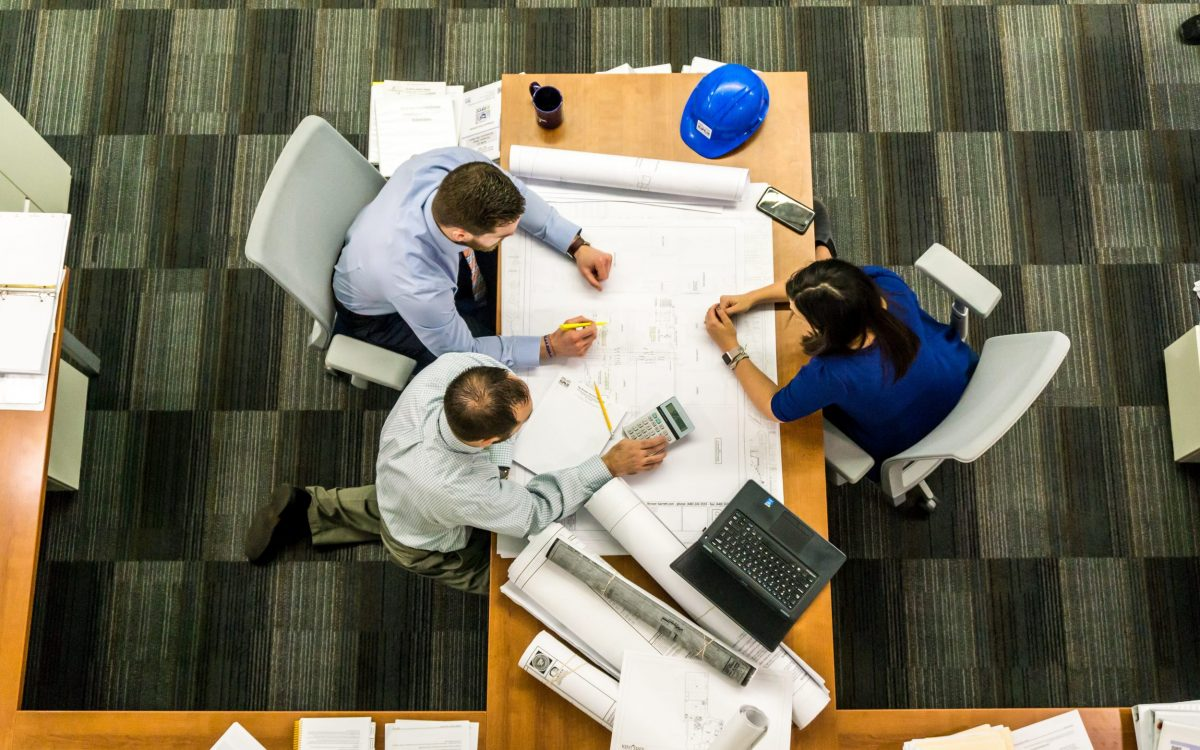 A group of people working at a desk