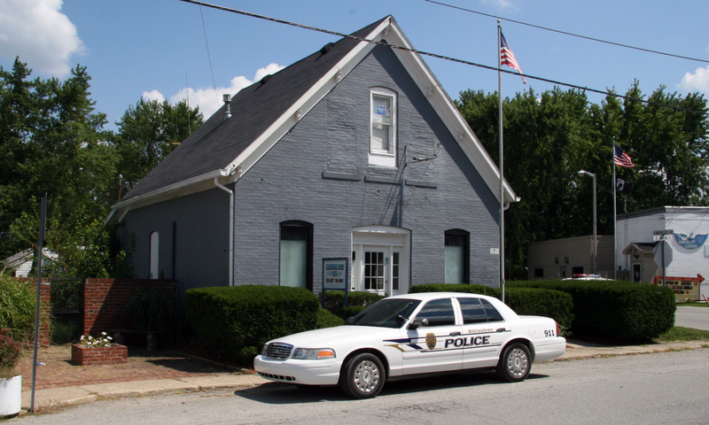 A police car parked in front of a business.