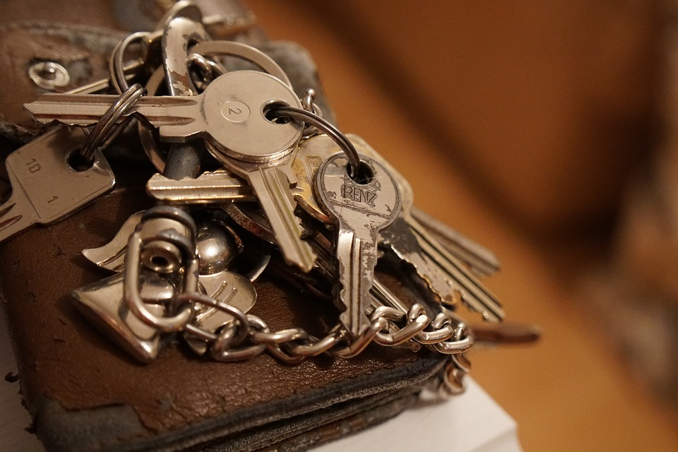 A keychain with several keys attached.