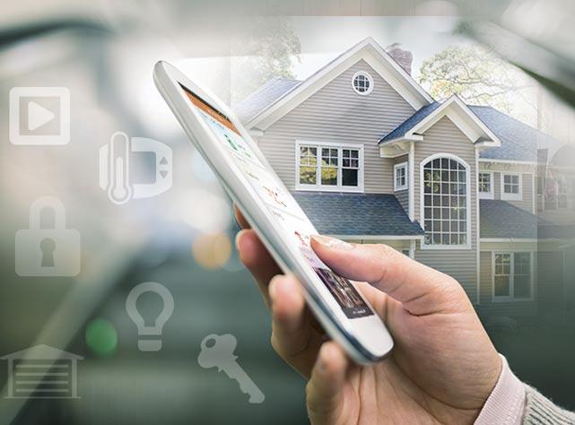 A homeowner using Alarm.com to control smart home devices.