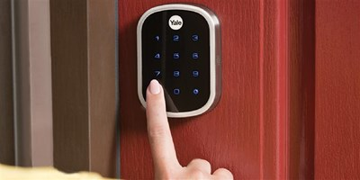 A Yale smart deadbolt is operated by a user.
