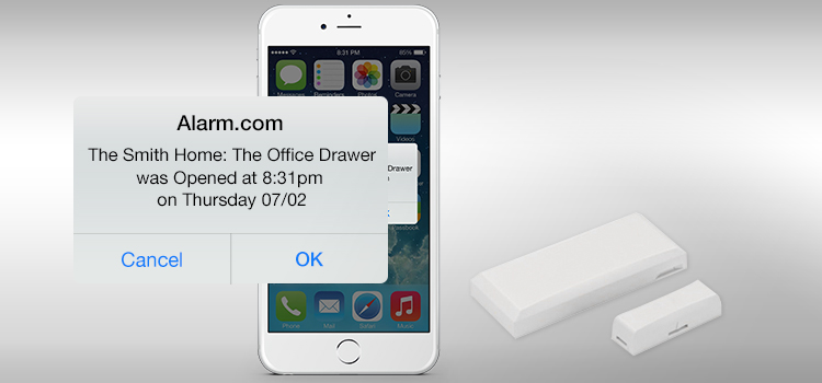 An Alarm.com Alert showing an open offcie drawer.