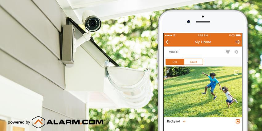 An Alarm.com outdoor camera monitoring a customer's yard.