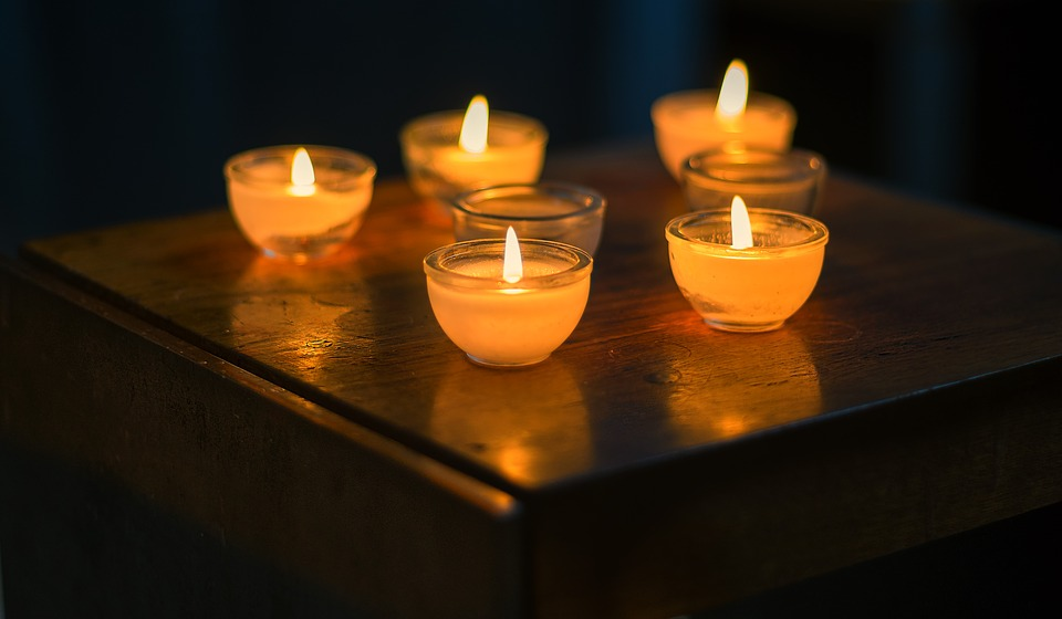 Several lit candles on a table