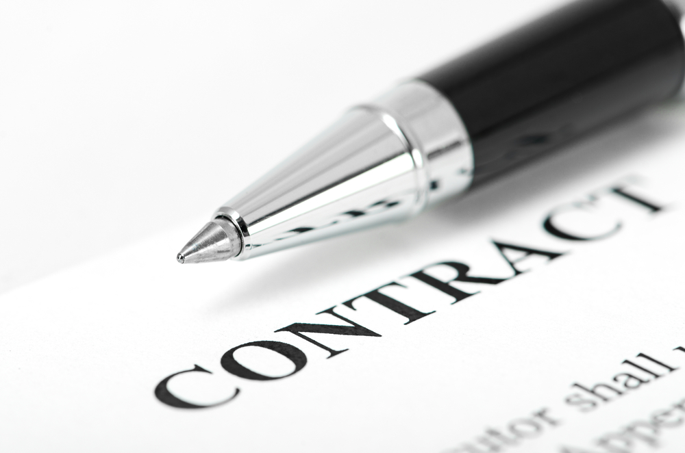 A contract and pen