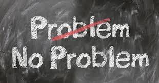 """A """"No Problem"""" message written on a chalkboard"""
