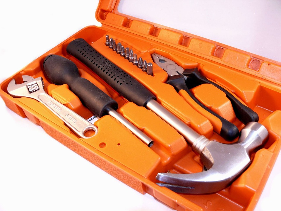 An open toolbox and tools