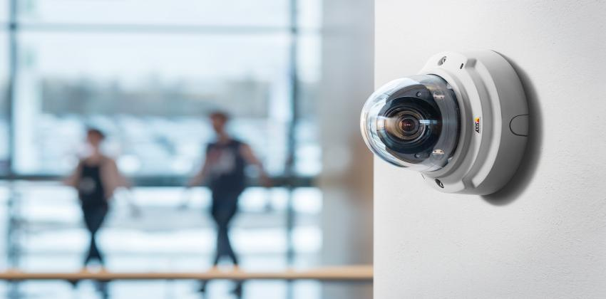 A camera on a wall inside a business.