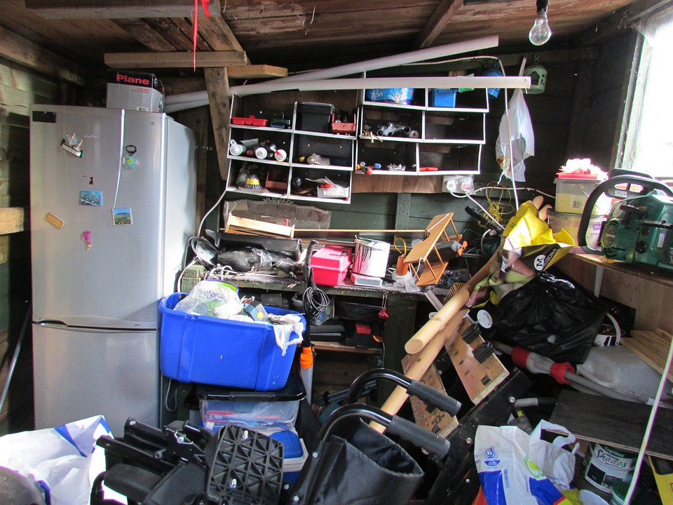A basement cluttered with trash.