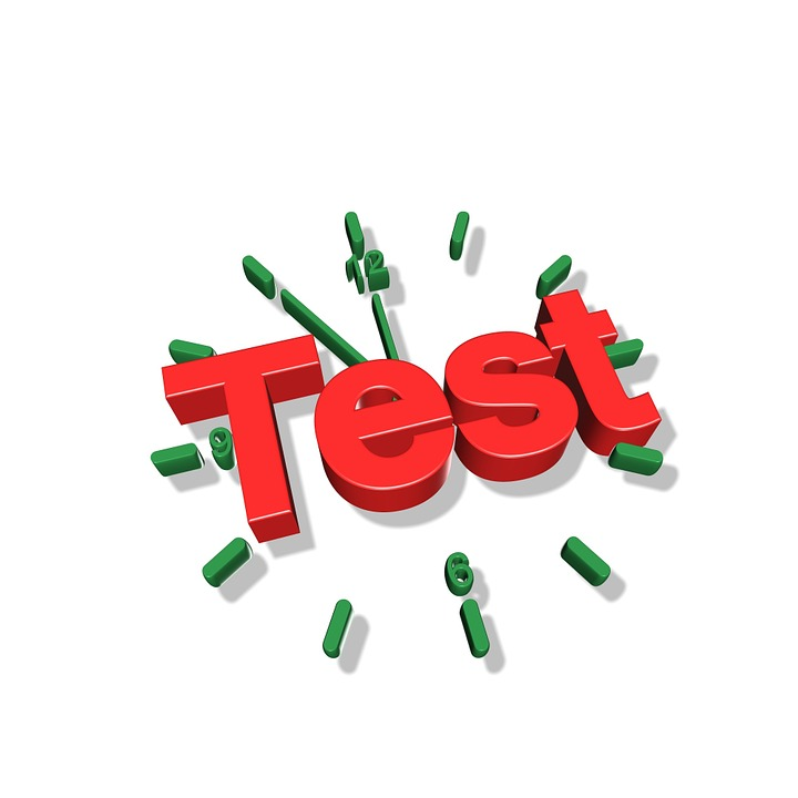 "The word ""Test"" imposed over the image of a clock."