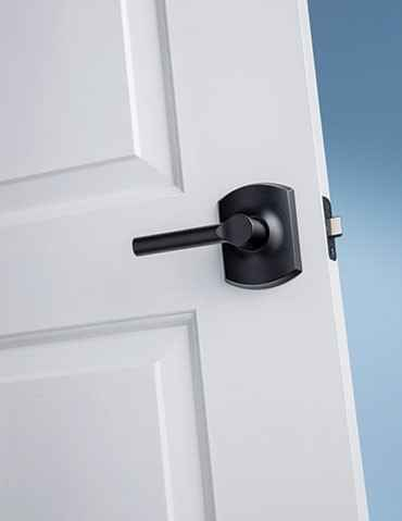 A Schlage passage lever on a door.