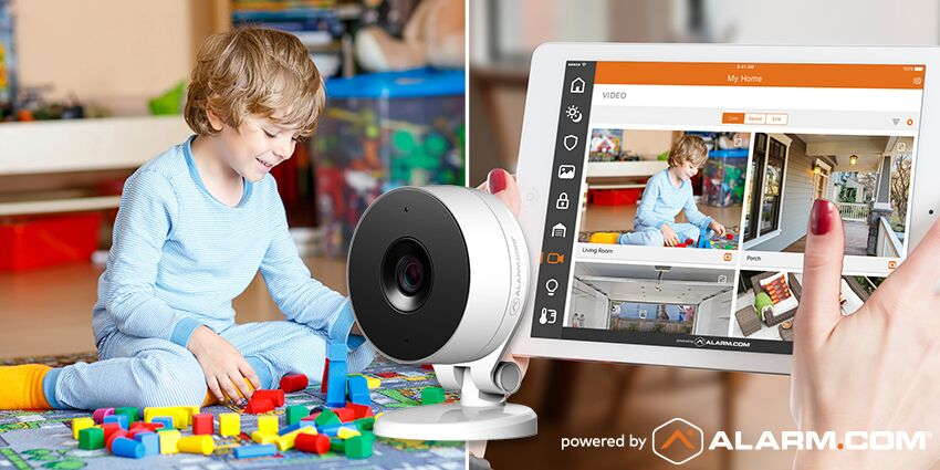 An Alarm.com camera showing a toddler playing.