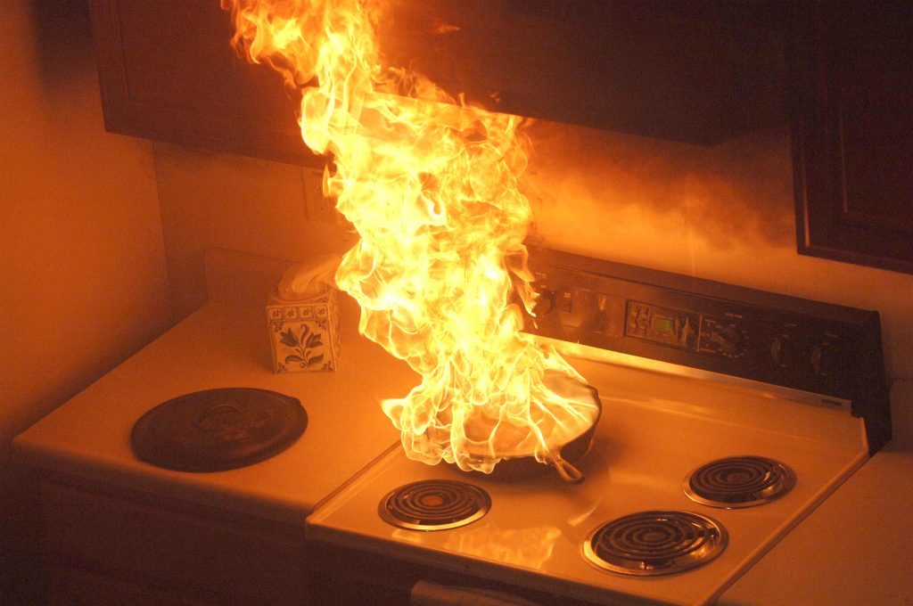 A stovetop fire starting in a pan