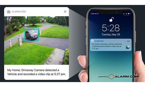 An Alarm.com camera clip showing a car driving into a driveway