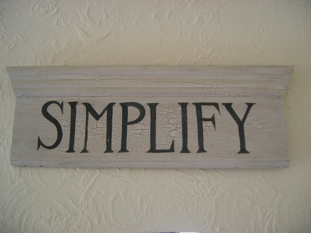 """A sign reading """"Simplify"""""""