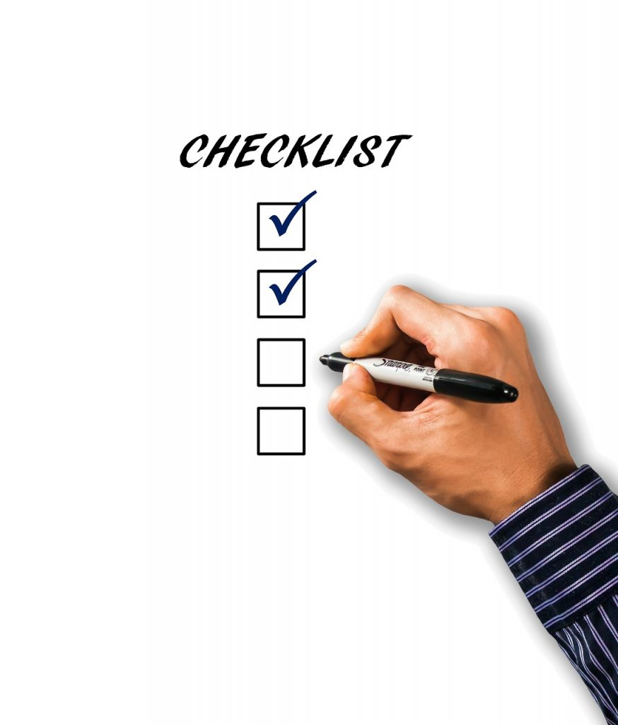 """A hand filling in a """"checklist"""""""