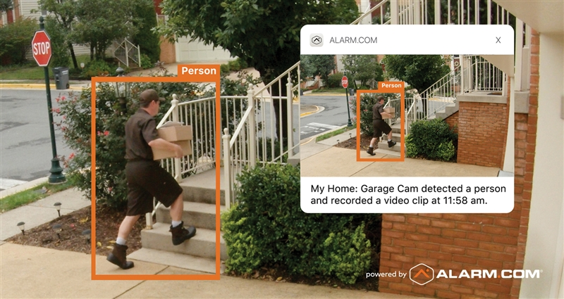 An Alarm.com smart camera video alert showing a person approaching a door.