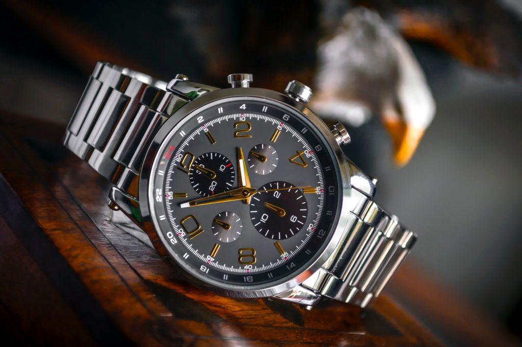 A silver watch on a desk