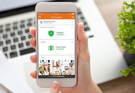 A smartphone with an open Alarm.com app.
