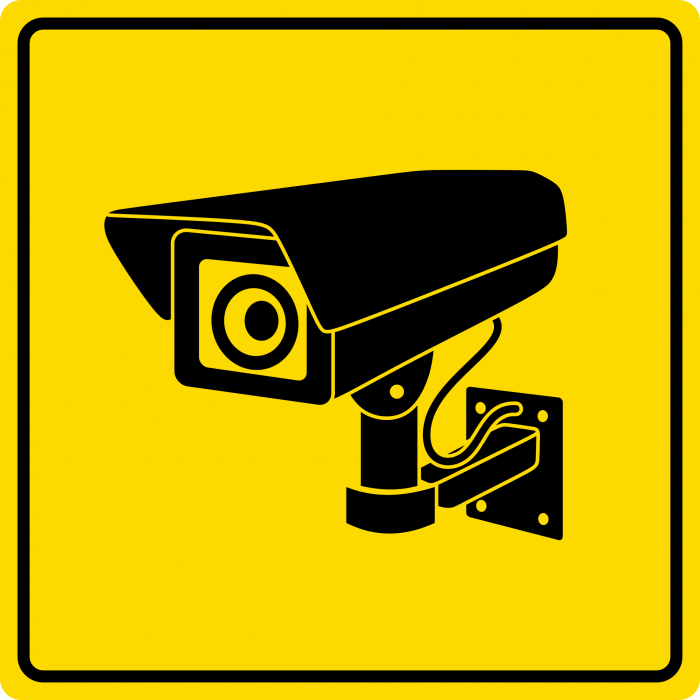 A yellow sign with a black camera