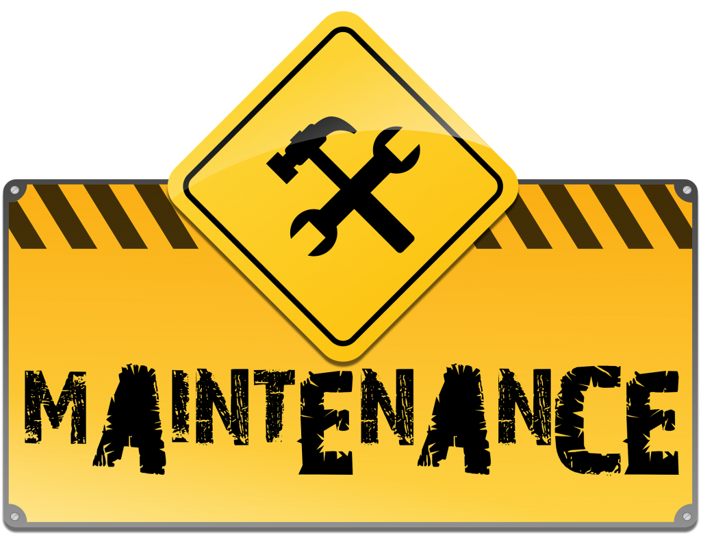 """A sign with a hammer and wrench reading """"Maintenance"""""""