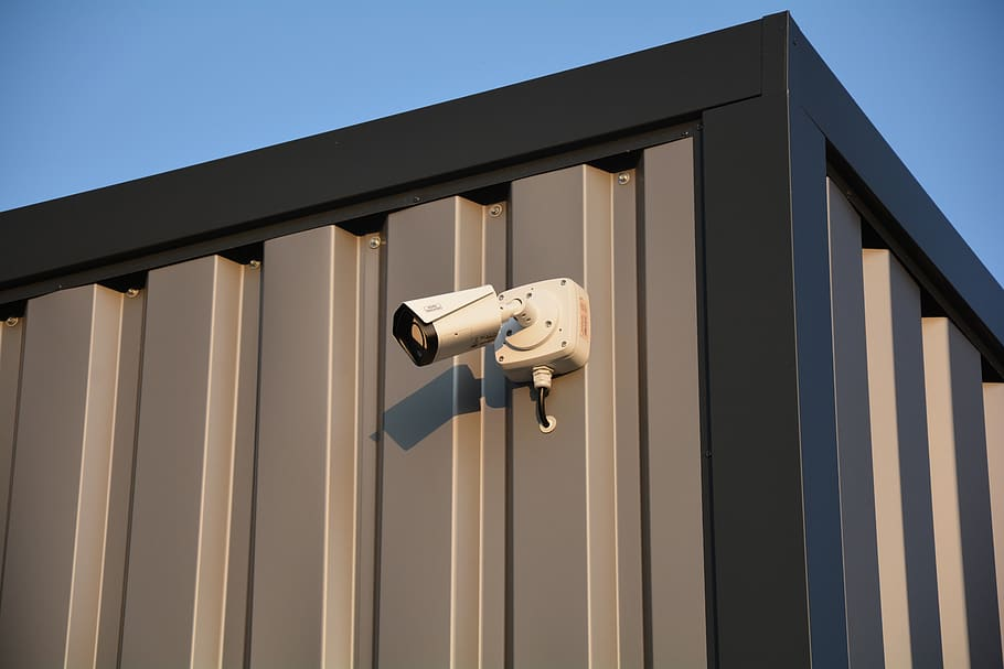 A security camera on the side of a building