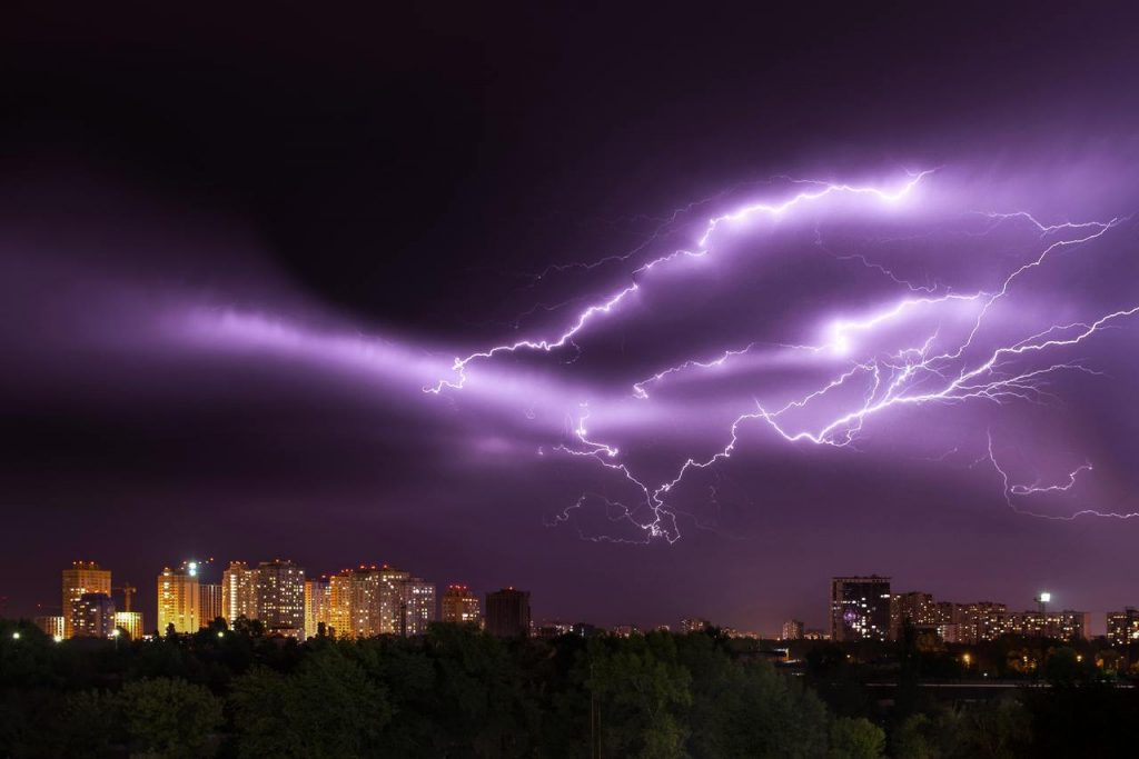 A strong thunderstorm above a city