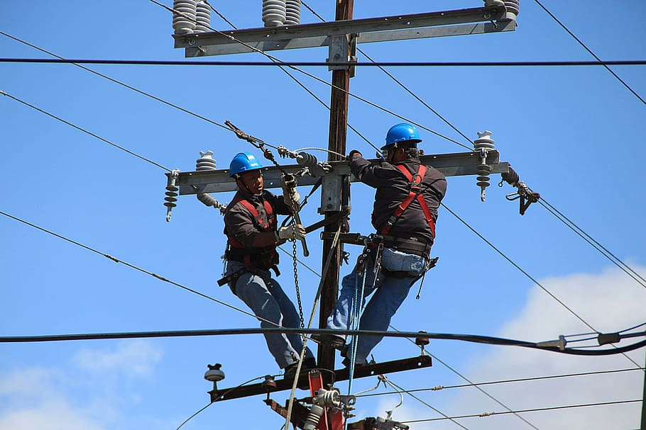 Telephone workers repairing phone lines.
