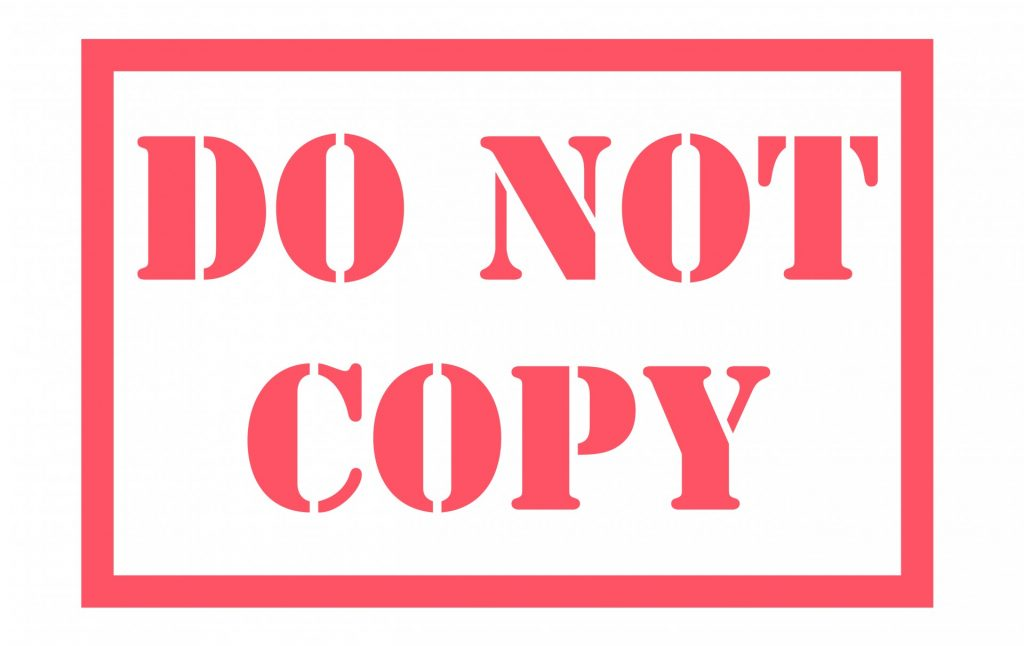 "A sign reading ""DO NOT COPY"""