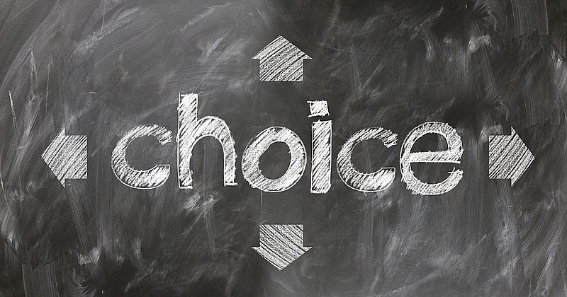 "A chalkboard with the word ""Choice"" and 4 arrows"