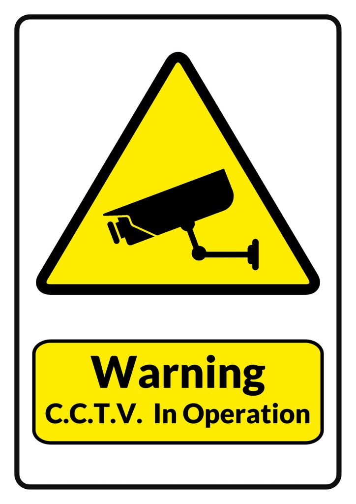 """A sign reading """"Warning, CCTV in Operation"""""""