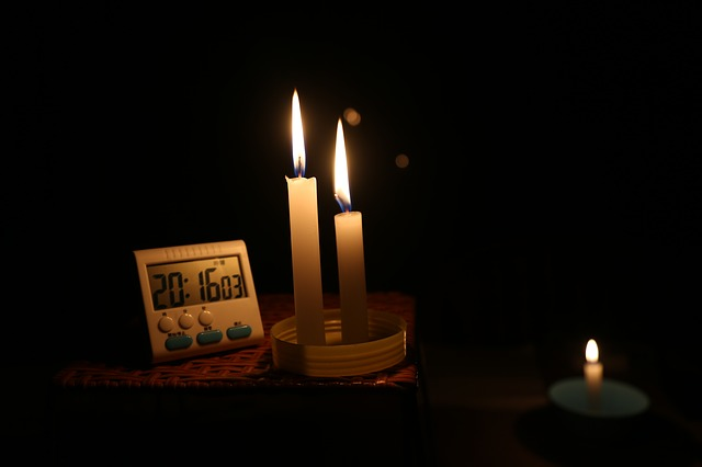 Candles and a clock on a counter