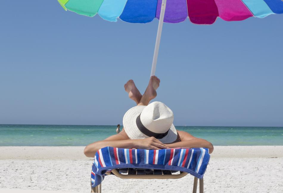 A person on vacation lounging on the beach