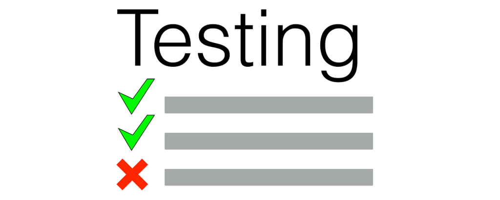 """A paper reading """"Testing"""" with check marks and an """"x."""""""