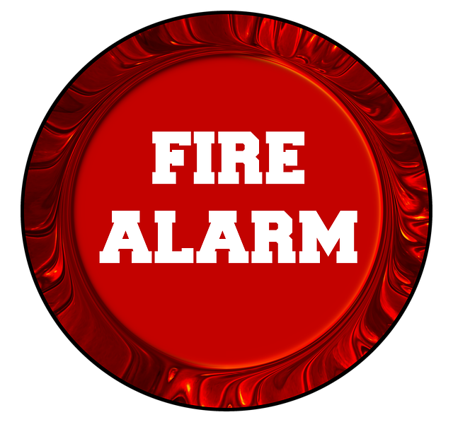 """A red circle reading """"Fire Alarm"""""""